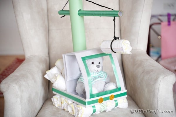 Diaper cake on grey chair