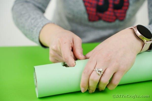 Folding paper into cardboard tube