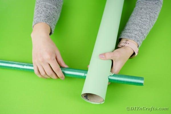 Sliding tube through bigger tube