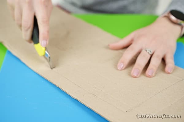 Cutting hole in cardboard