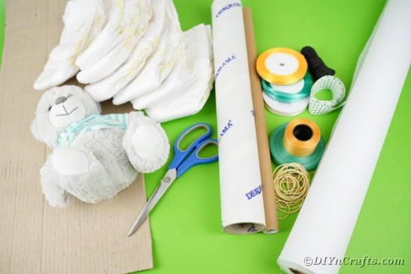 Supplies for making a crane diaper cake
