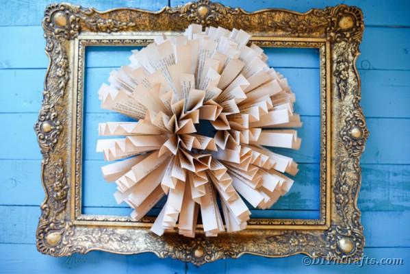 Paper flower wall art on blue wall