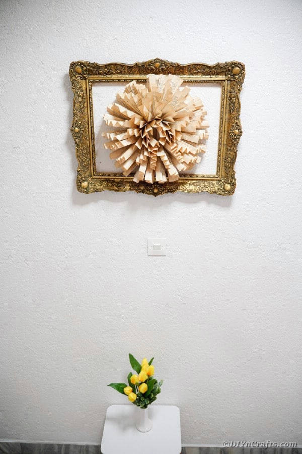 Paper flower wall art hanging on wall