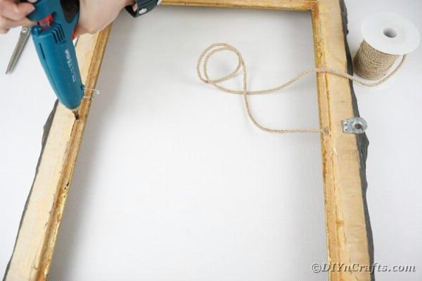 Adding twine to frame