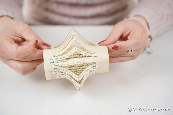 Stapling cut page on lantern