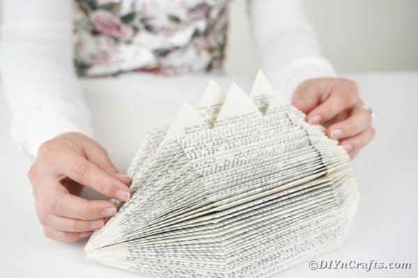 Gluing spikes onto book hedgehog