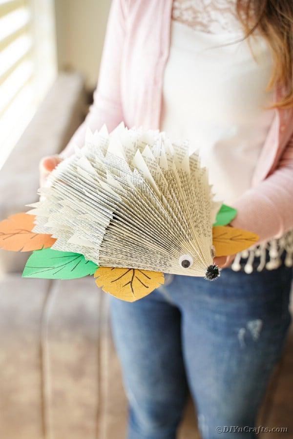Woman holding paper hedgehog
