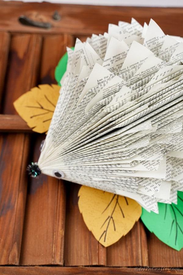 Paper hedgehog on wooden slats