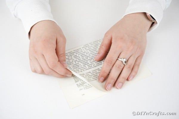Woman folding book page