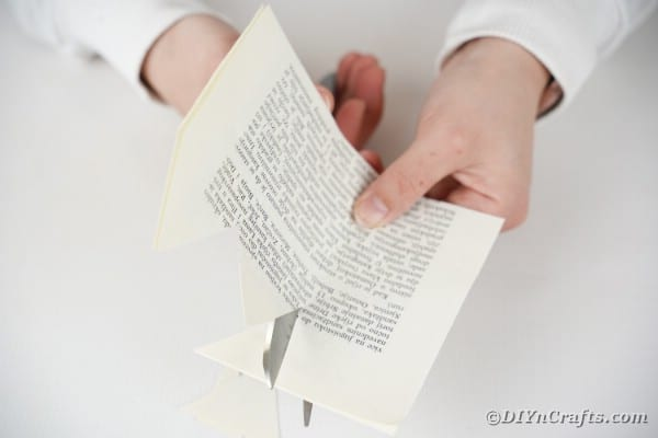 Cutting spikes on book page