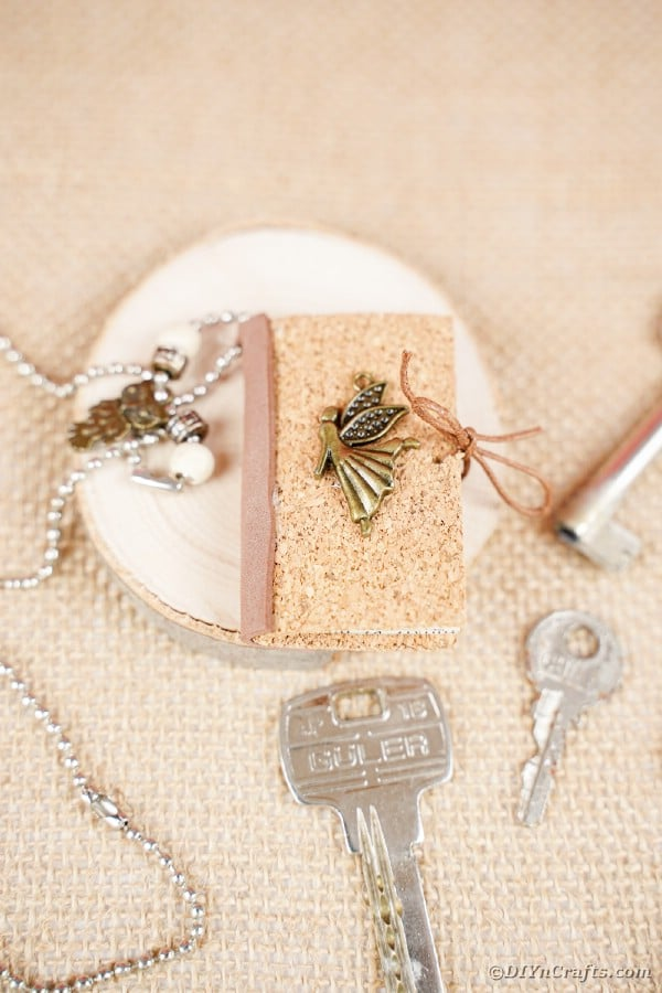 Mini book keychain on burlap surface