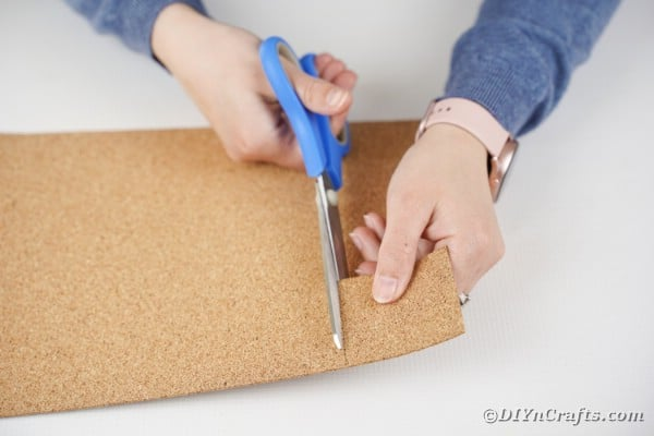 Cutting cork sheet into book binding