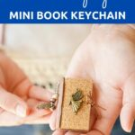 Woman holding book page keychain