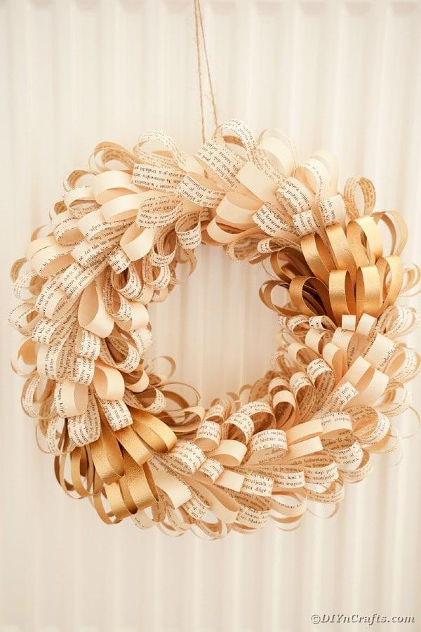 Paper rolls wreath on wall