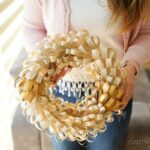 Woman holding fringed wreath