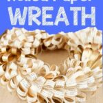 Book page wreath on brown surface