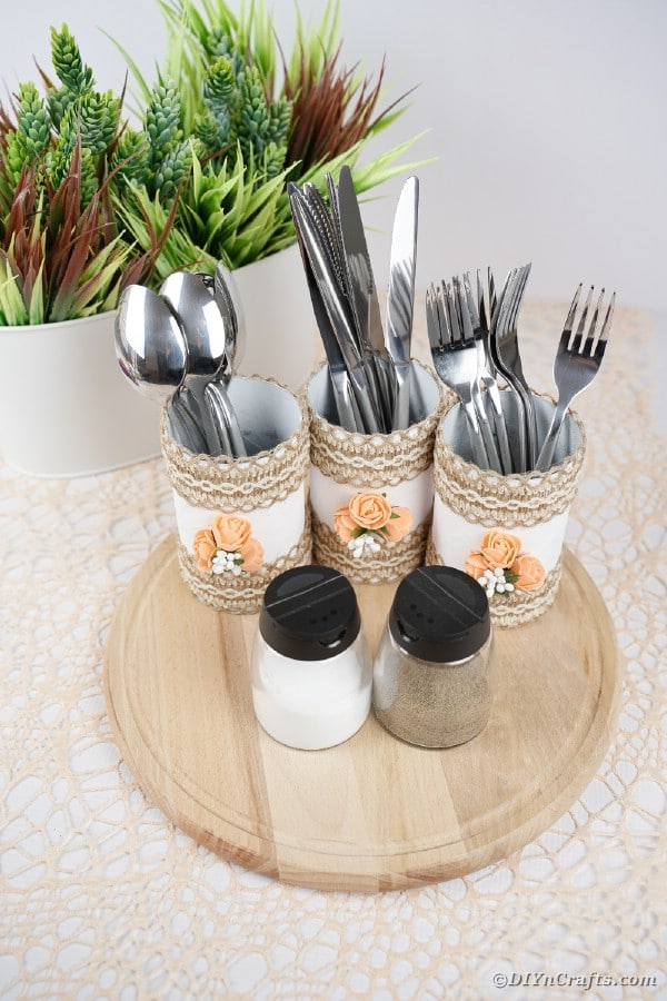 Storage cans with utensils on white table