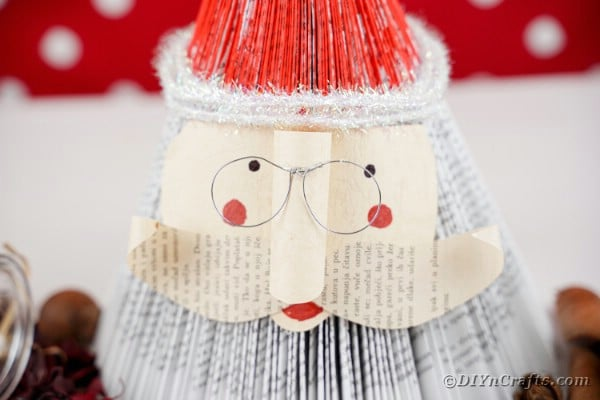 Book Santa Claus in front of red polka dot background