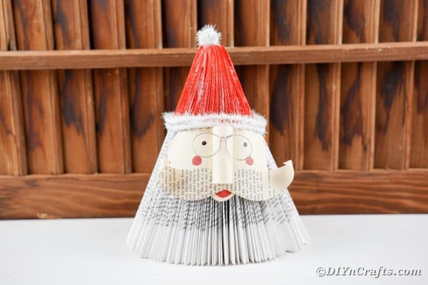 Book santa claus in front of wooden slats