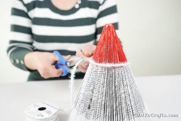 Adding ribbon around santa hat