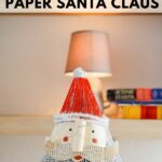 Old book santa Claus on table in front of lamp