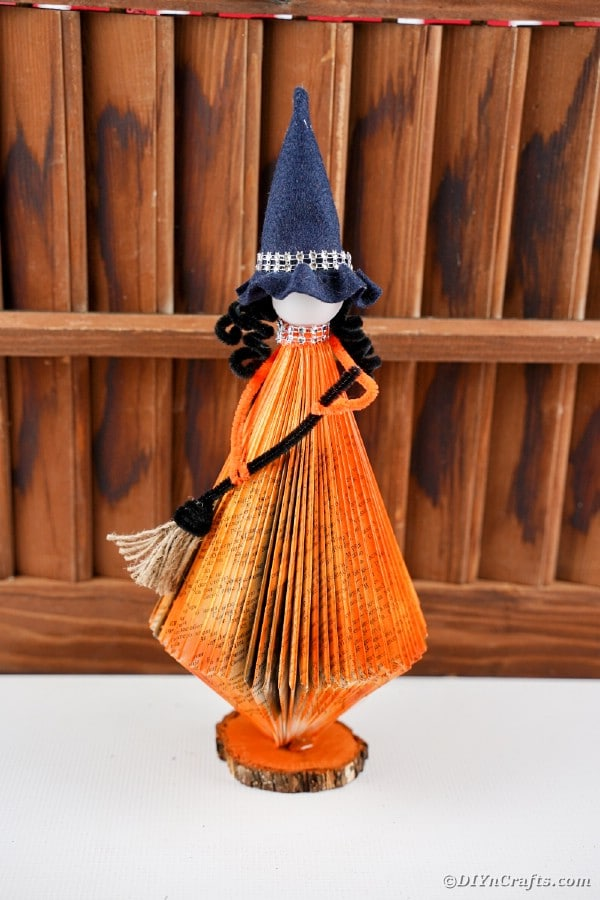 Orange witch in front of slats