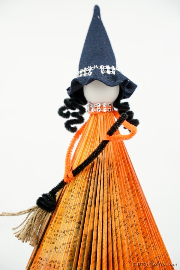 Orange paper book witch with white background