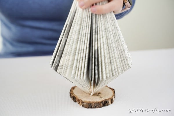 Standing folded book on stand