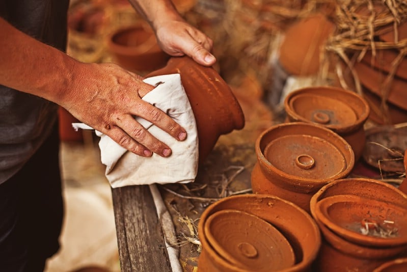 Cleaning clay pots using vinegar.