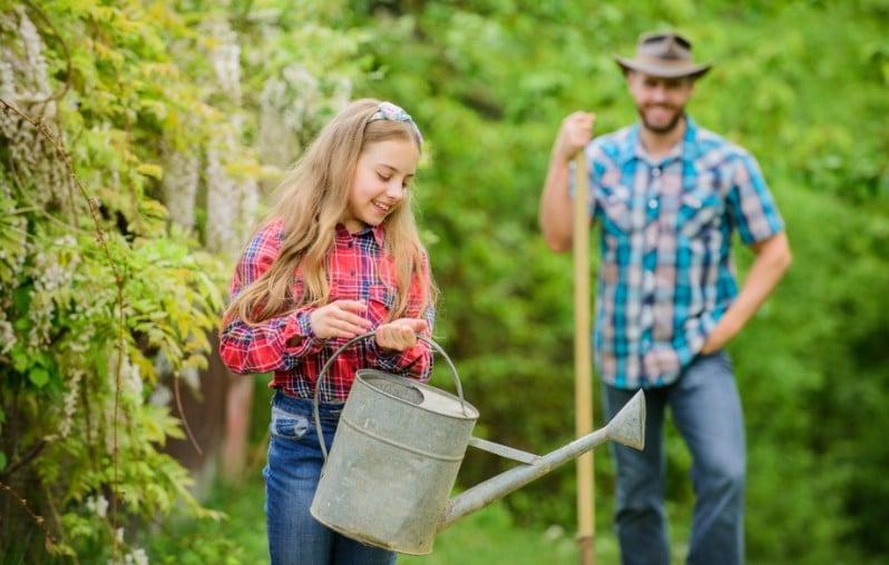 Couple doing garden chores.