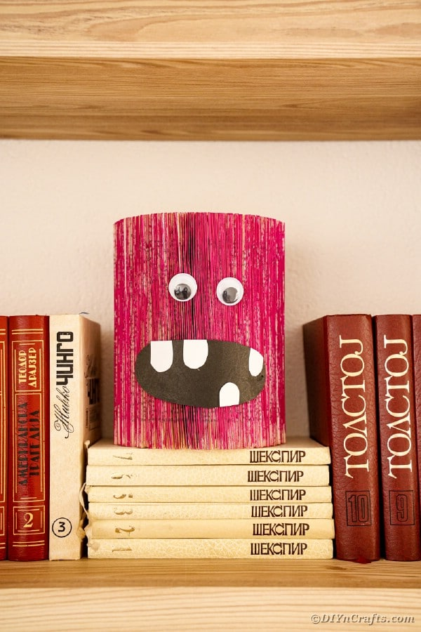 Old book pink monster craft on stack of books