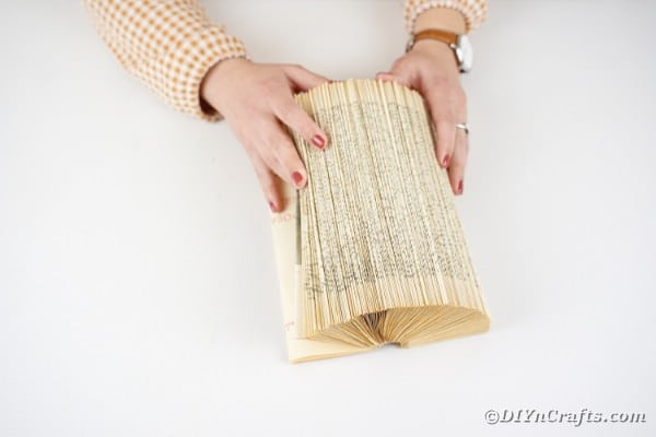 Folding pages in old book