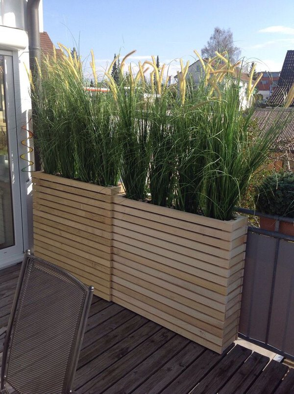 Vertical wood slat planter with grass