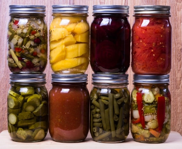 Stacks of canned vegetables in mason jars