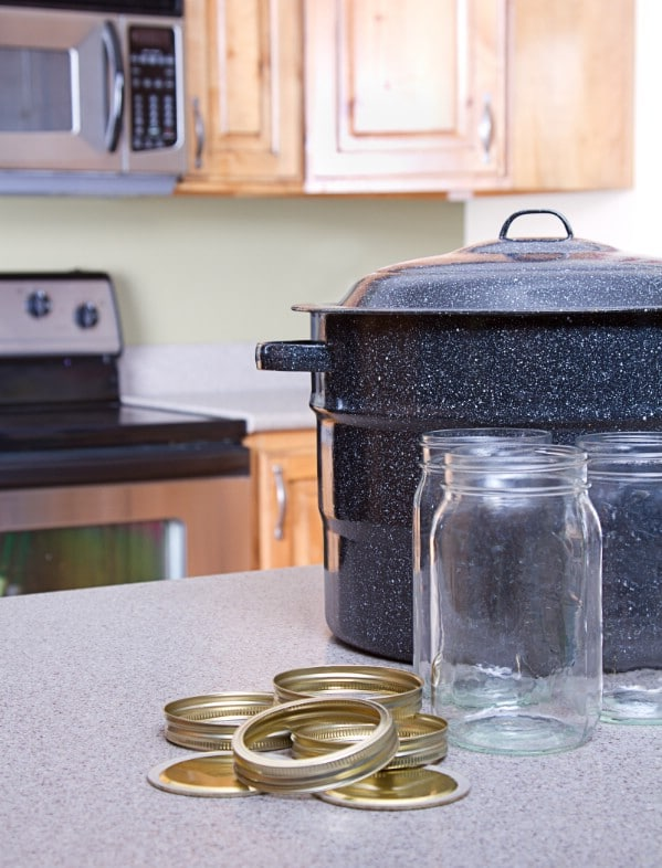 Black stockpot by mason jars
