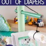 Diaper crane on white table