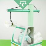 Diaper crane on green surface