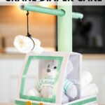Diaper crane on wood table