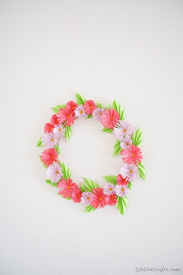 Chrysanthemum wreath on white wall
