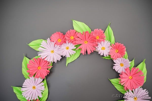 Flower wreath on gray wall