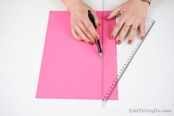 Measuring pink paper