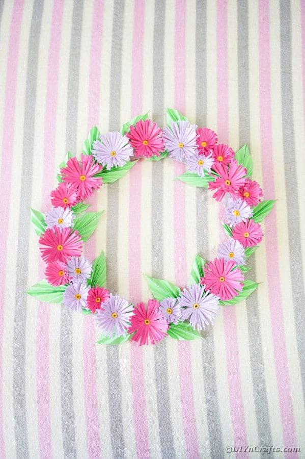 Flower wreath on striped wall