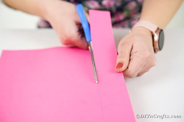 Cutting pink paper