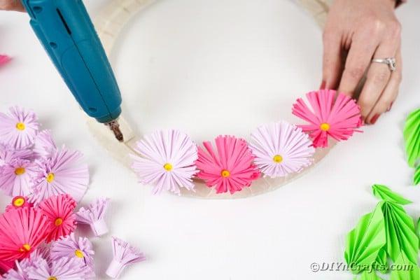 Gluing flowers onto wreath