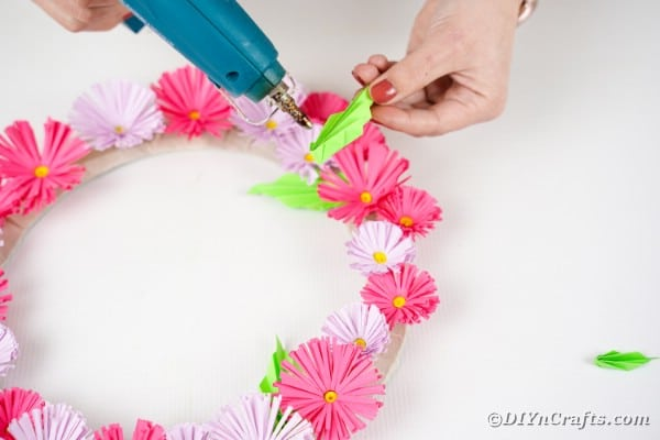 Gluing leaves on wreath
