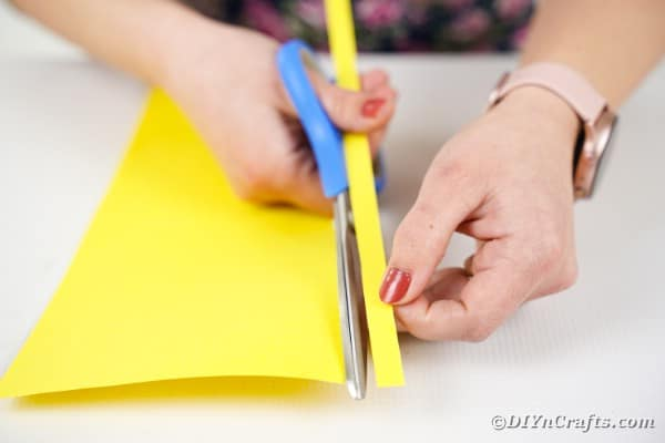 Cutting yellow paper
