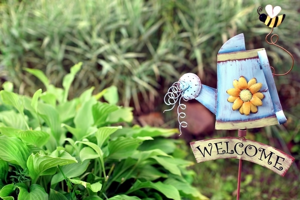 Metal watering can sign