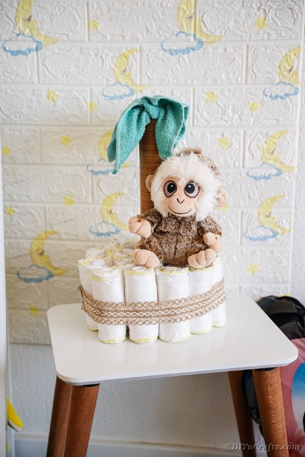 Diaper cake by white brick wall