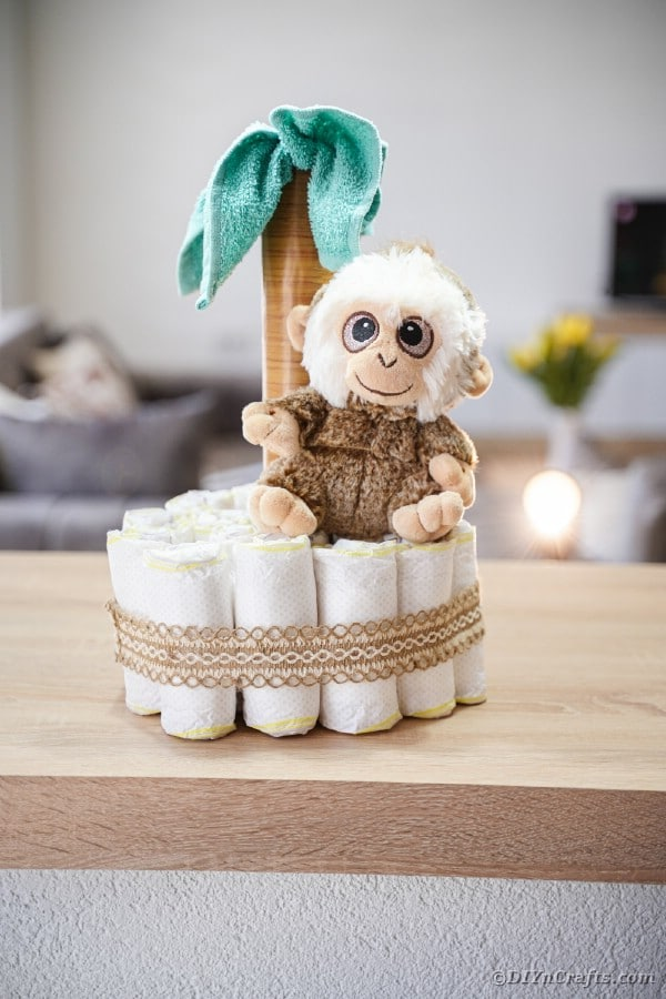 Jungle palm tree diaper cake on wood table