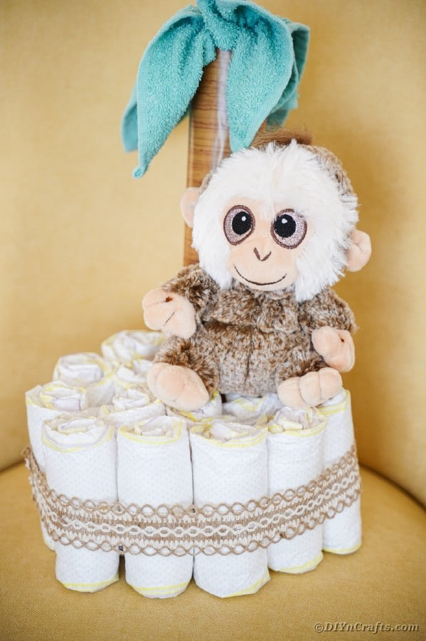 Palm tree diaper cake in yellow chair